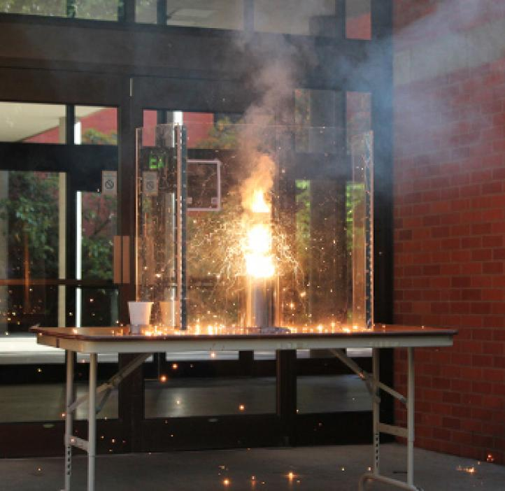 flaming chemistry experiment on table
