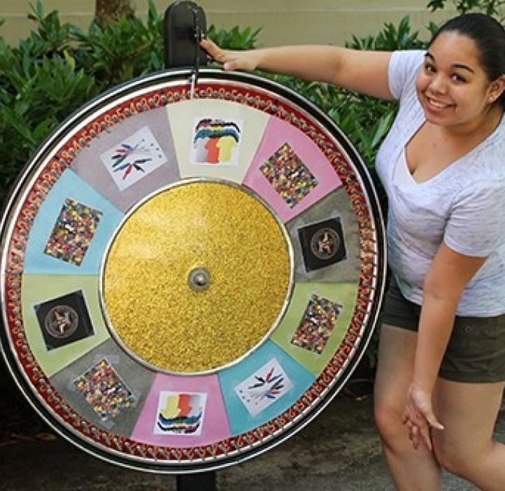 student spinning chemistry wheel