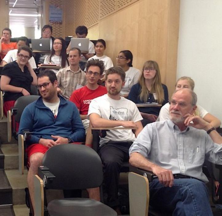 faculty and students sitting in lecture hall