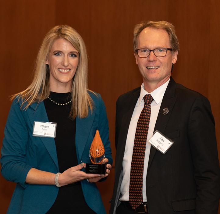Megan Cook receiving award from Roy Haggerty