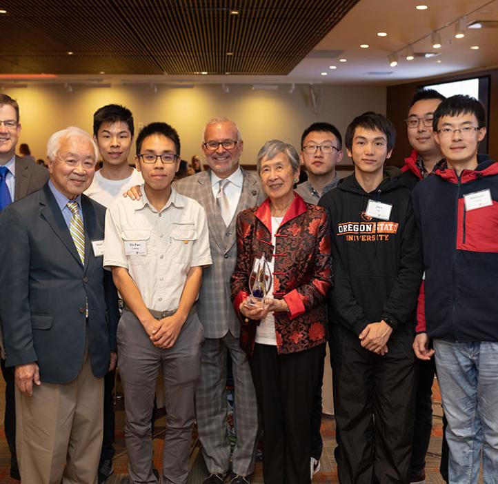 Edward and Janet Chen, and John Donnelly with students and staff