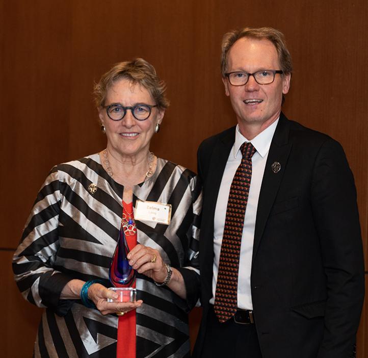 Zelma Long receiving award from Roy Haggerty