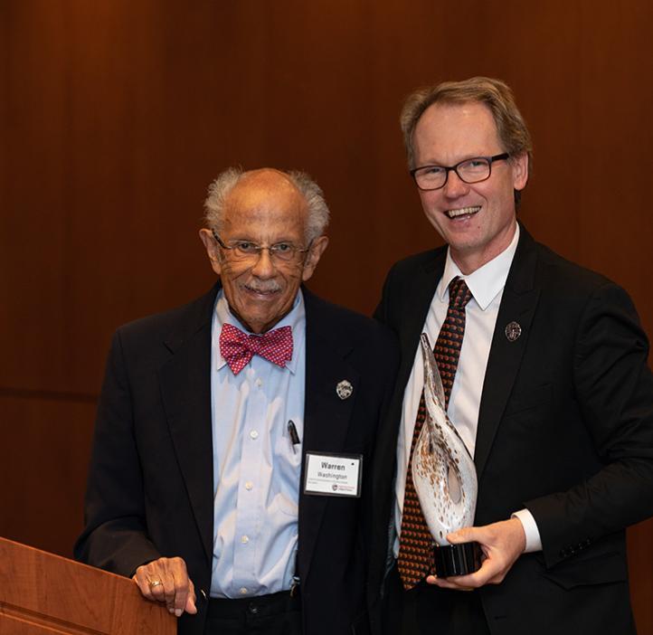 Warren Washington receiving award from Roy Haggerty