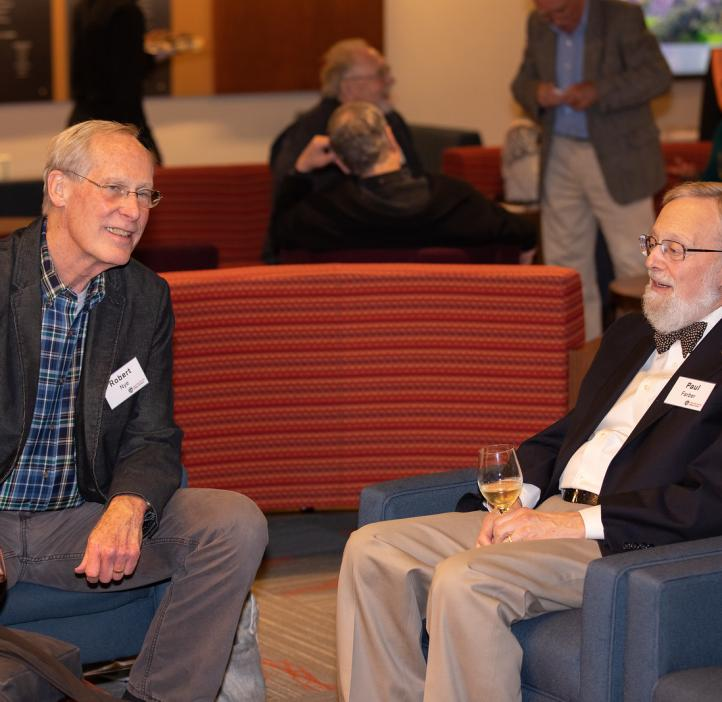 Paul Farber and Robert Nye talking in lobby