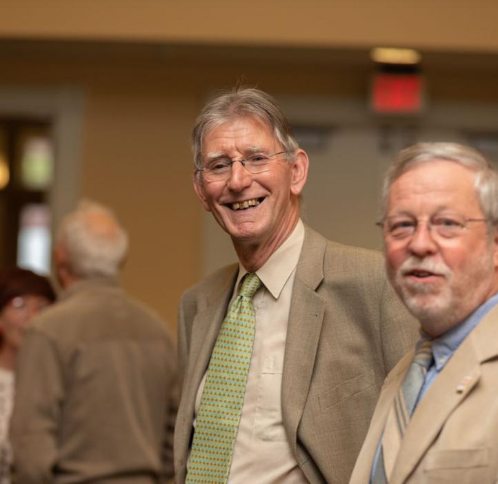 Henri Jansen and Robert Mason chatting in lobby