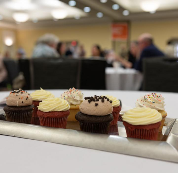 cupcakes sitting in center of table