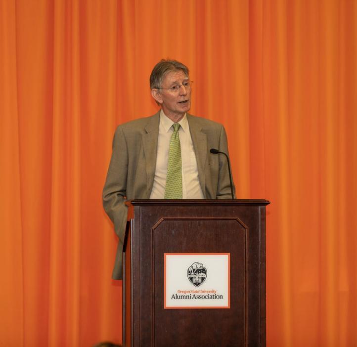 Henri Jansen speaking from podium