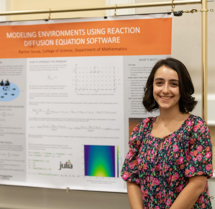 Rachel Sousa standing next to her research poster