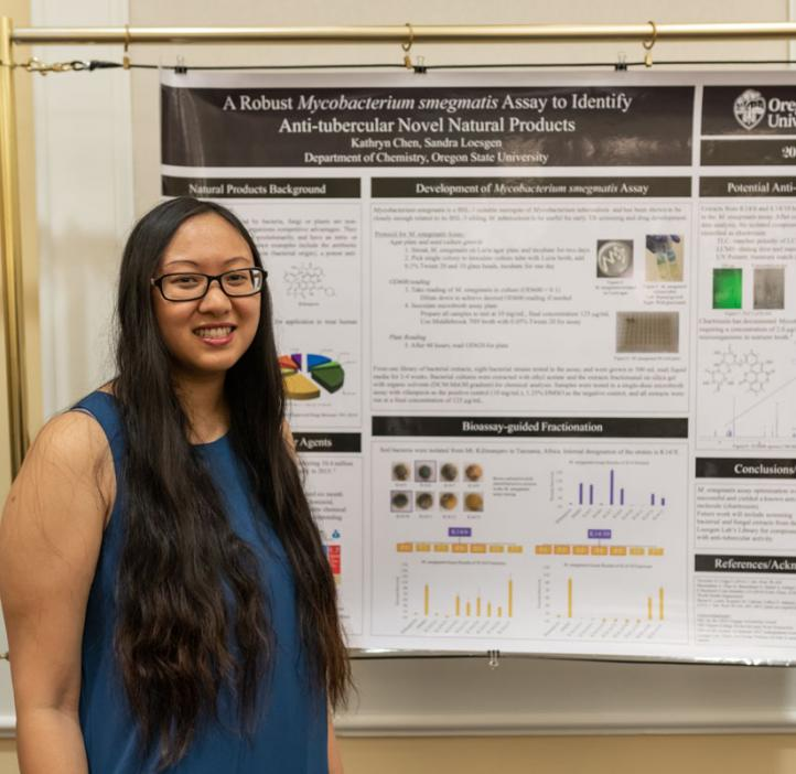 Kathryn Chen next to research poster