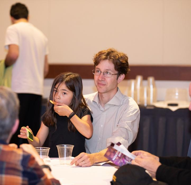 Ethan Minot with daughter at table