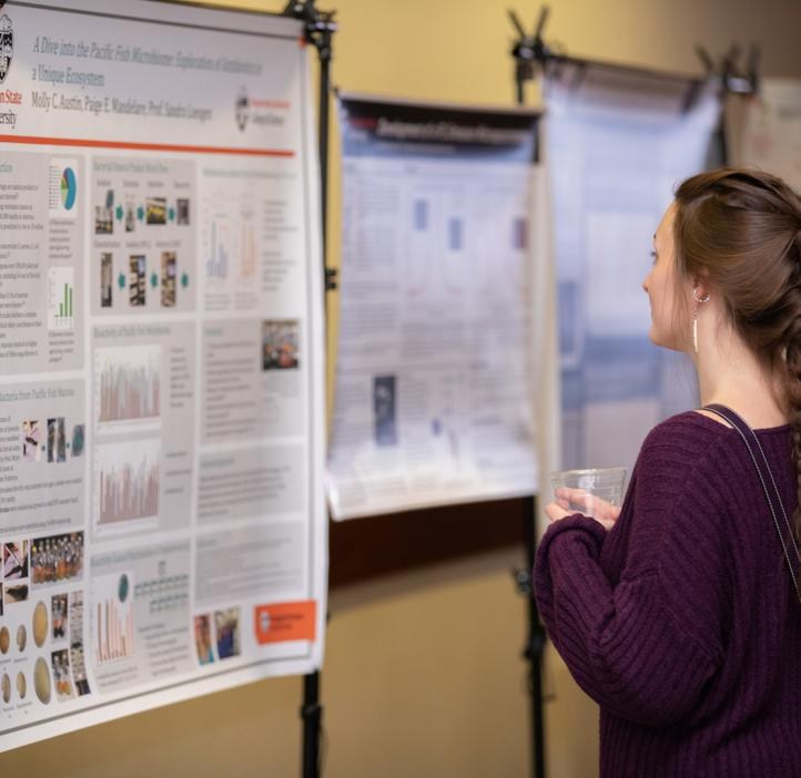 Student checking out research posters