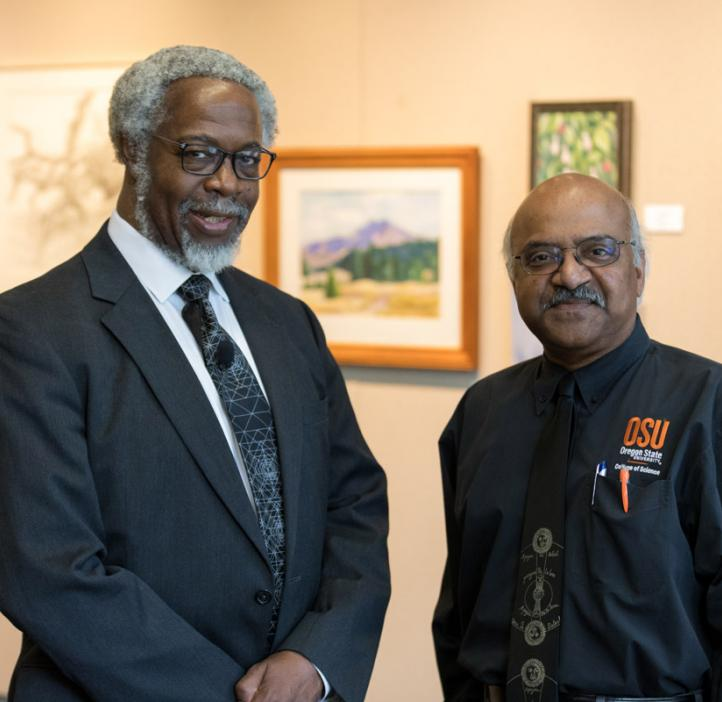 "Sylvester James ""Jim"" Gates, Jr. and Sastry Pantula standing next to artwork"