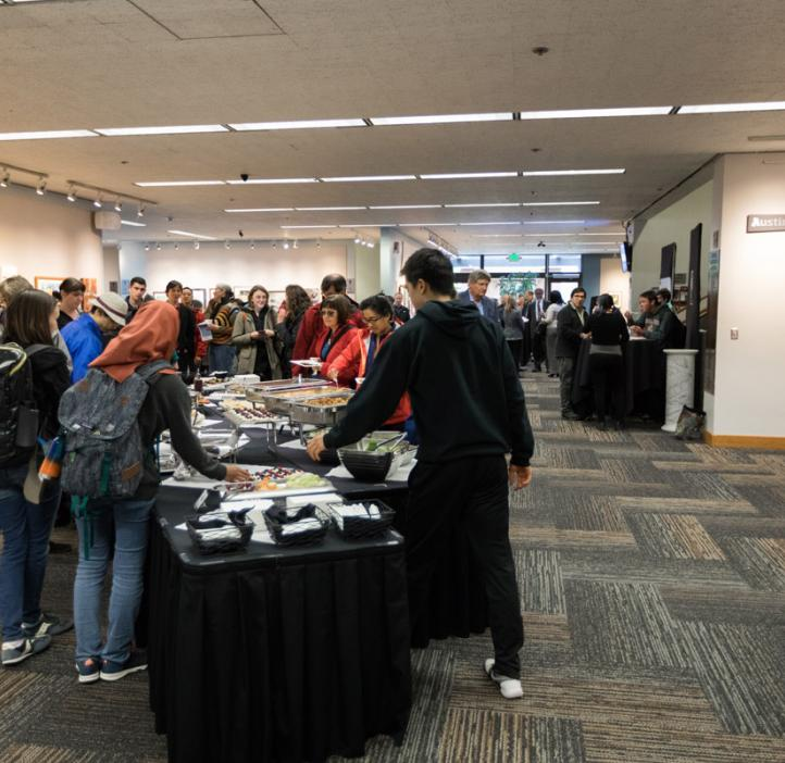 students and event attendees grabbing food