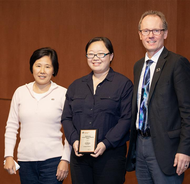Jie Zhang (center) with Chemistry Professor Wei Kong and Dean Roy Haggerty