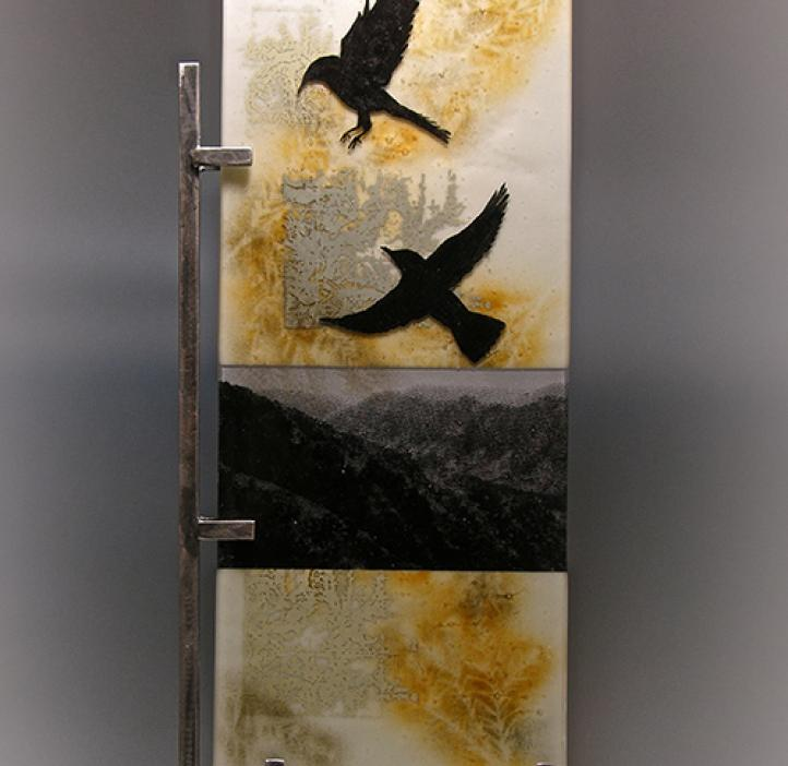 art piece depicting crows flying over mountains