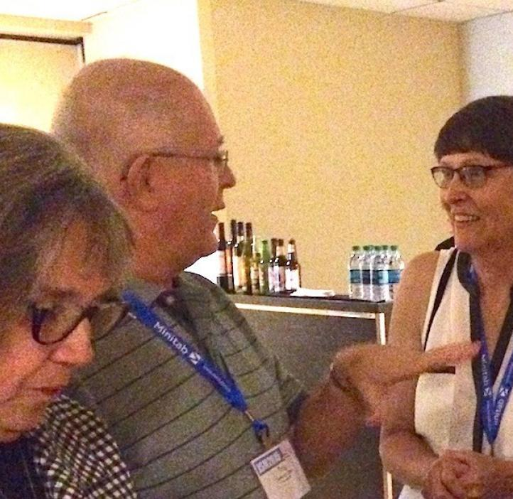 Staistics Department chair Ginny Lesser talks with alumni