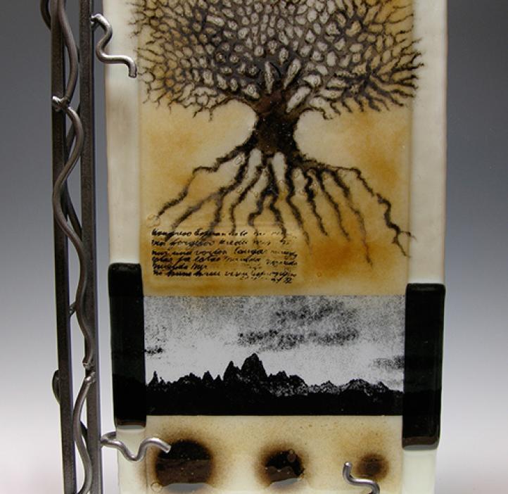 art piece depicting tree and mountain range