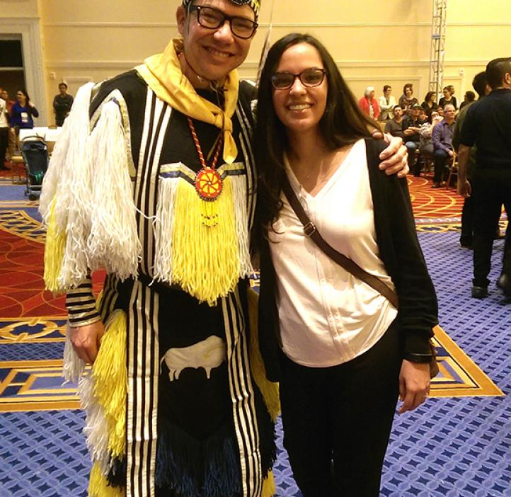 OSU SCANAS student with traditionally dressed representative in lobby