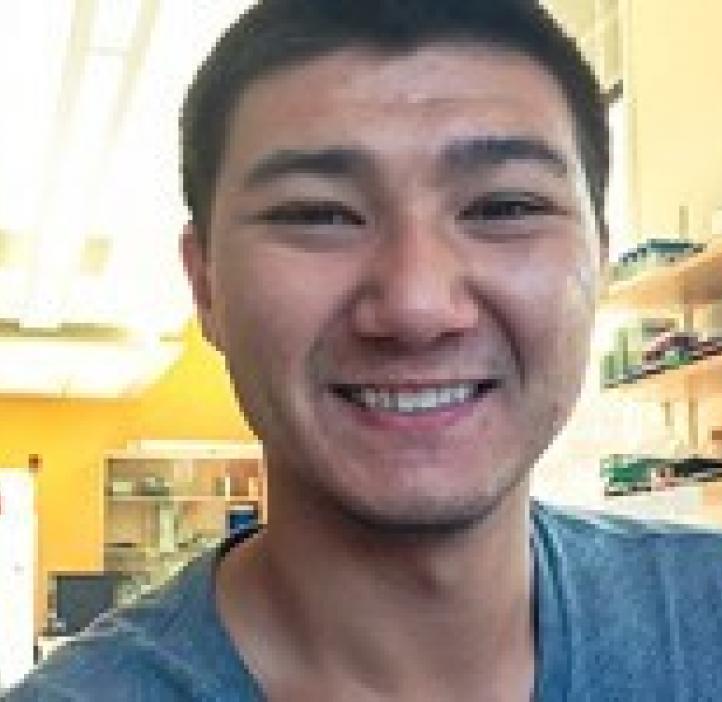 Aaron Sugiyama sitting in lab
