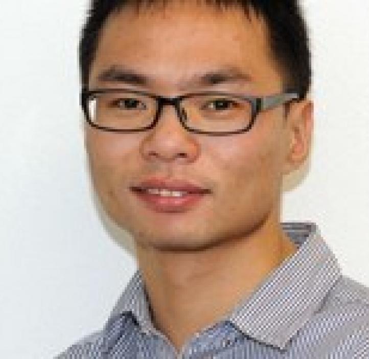 Bin Zhuo in front of white backdrop