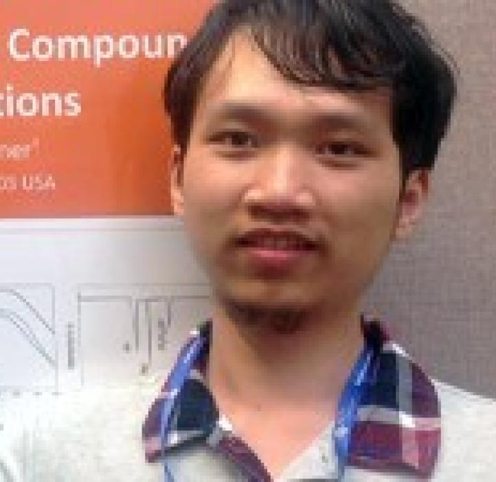 Hanyang Zhang in front of research poster