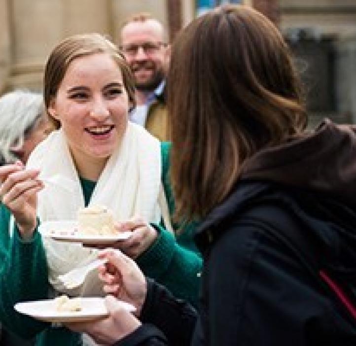 female students talking over cake