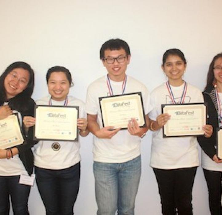 student winners holding awards in group photo