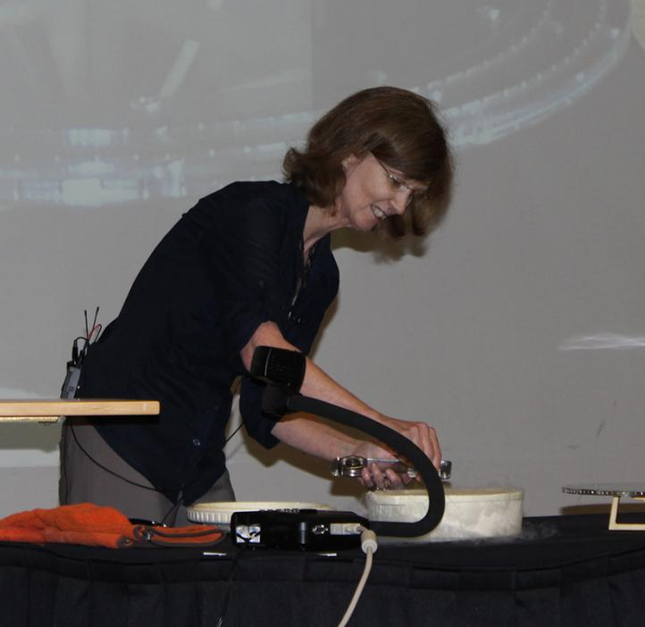 Janet Tate performing experiment of stage