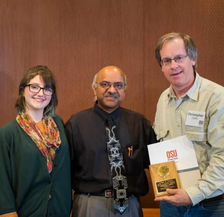 Loyd Carter award winner Chris Coffin and his student Sarah Devine with Dean Sastry Pantula