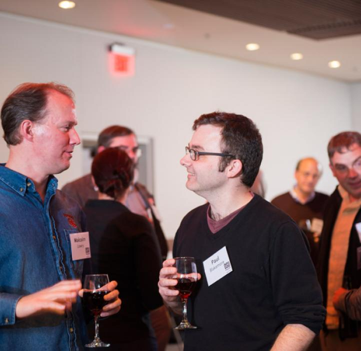 Loyd Carter award nominee Malcolm Lowry talking with colleagues over wine