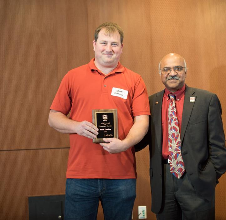 Mark Dunbar receiving award from Sastry Pantula