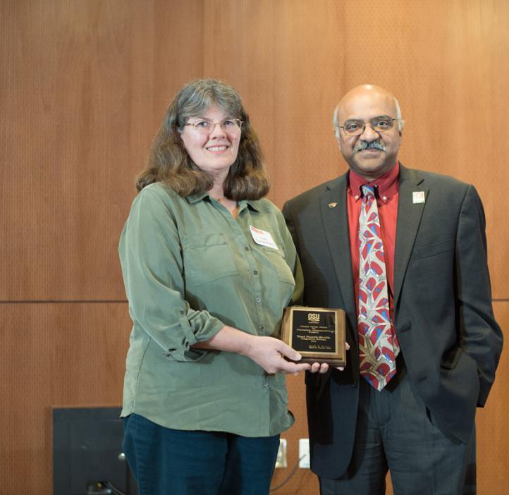 Traci Durrell-Khalife receiving award from Sastry Pantula