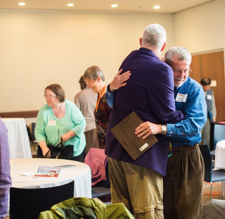 Robert Mason hugging Mark Lavery in lobby