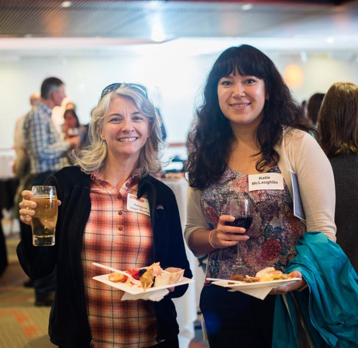 Rebecca Vega-Thurber and Katie McLaughlin grabbing food and drinks in lobby