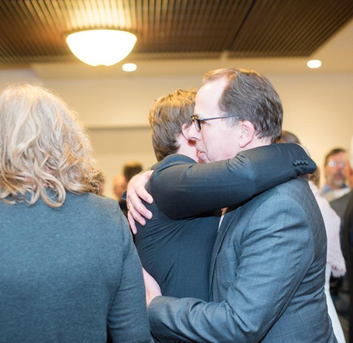 Scott Clark hugging male