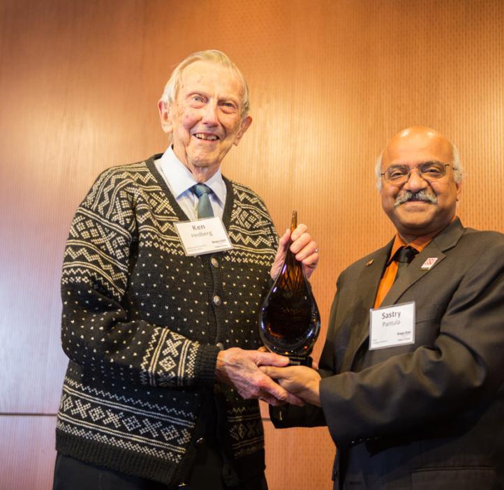 Ken Hedberg receiving award from Sastry Pantula