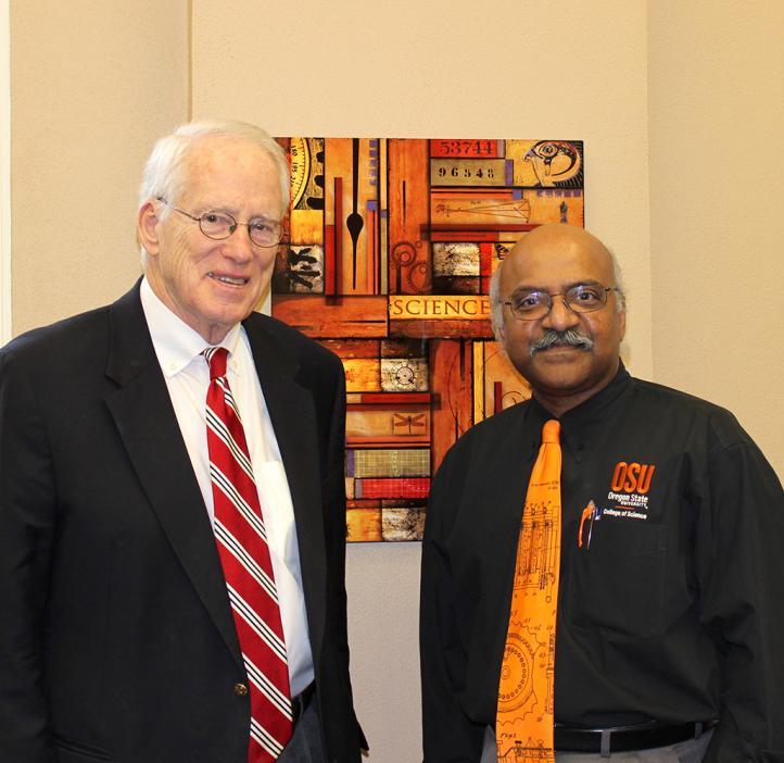 William Kirwan and Sastry Pantula standing in office space