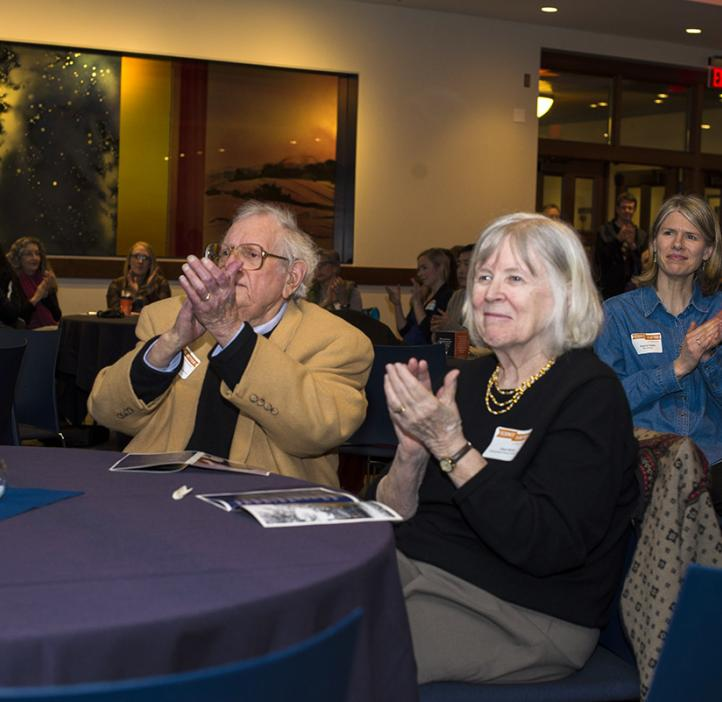 Fred and Clara Horne clapping from table