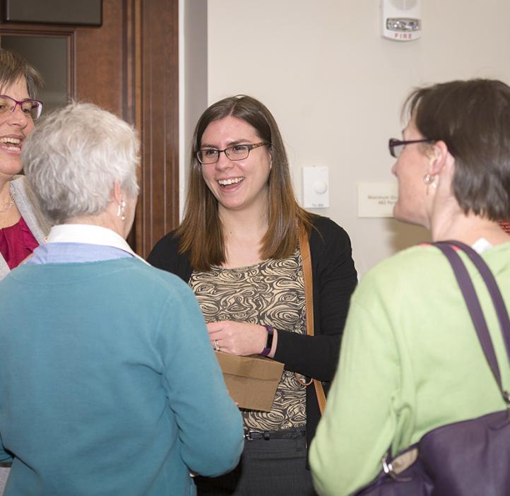Karen Van Zee talking with colleagues