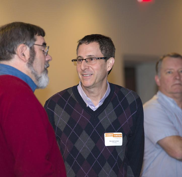 Mike Lerner talking with faculty