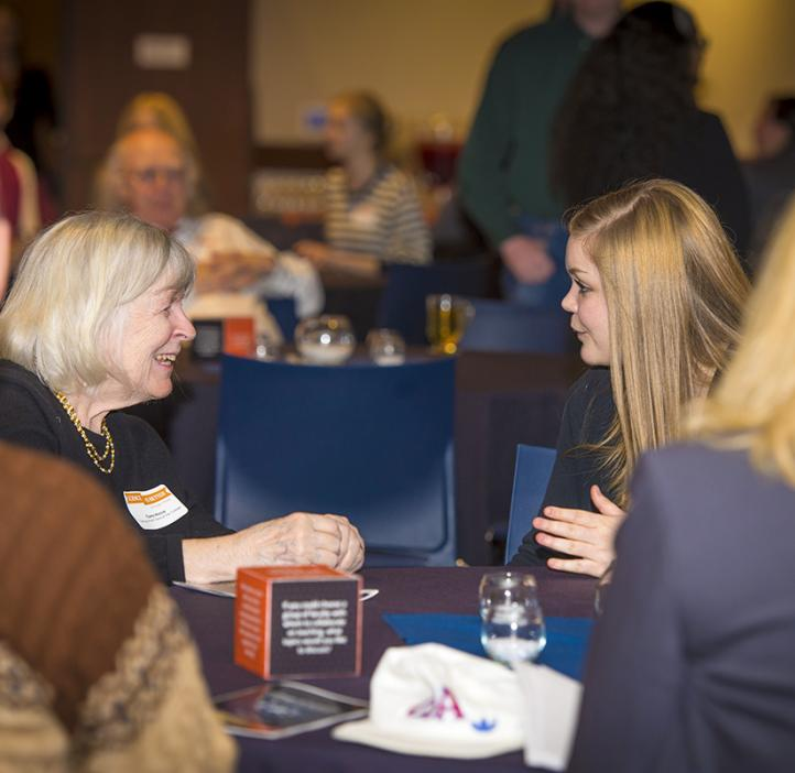 Female colleagues talking at table