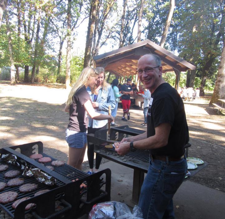 Andy Karplus grilling burgers