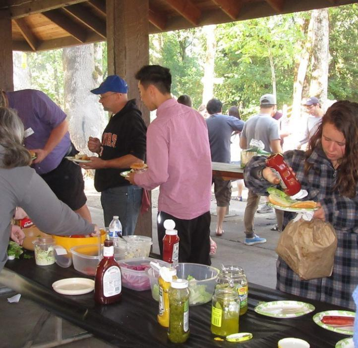 students and family at condiment bar