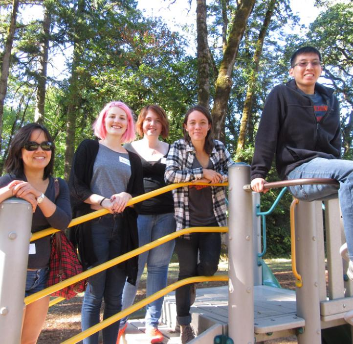 science students sitting on play structure
