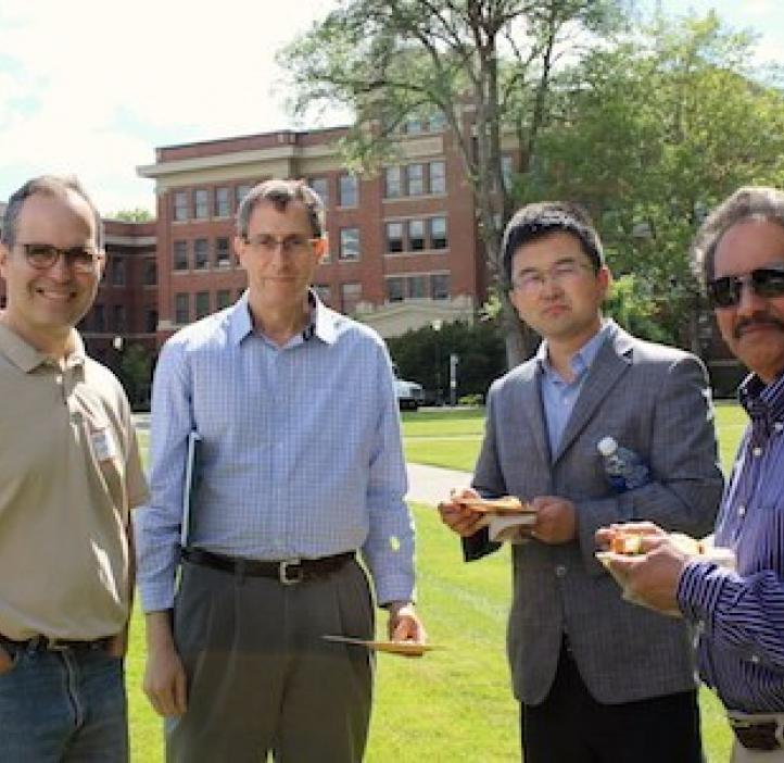male science faculty standing in Valley Library field