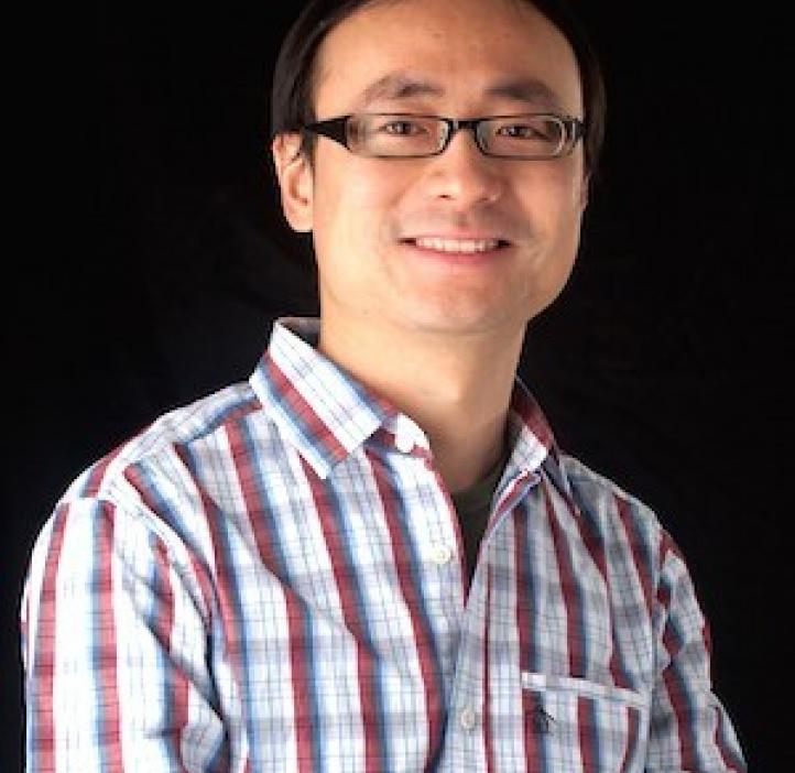 Chong Fang, Chemistry professor in front of black backdrop