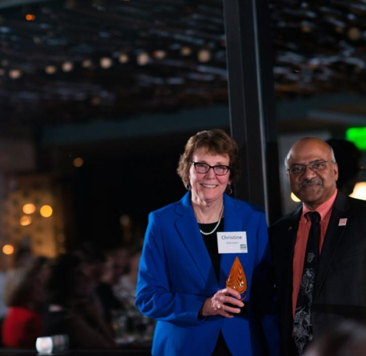 Christine Vernier, receiving Distinguished Service Award from Sastry Pantula