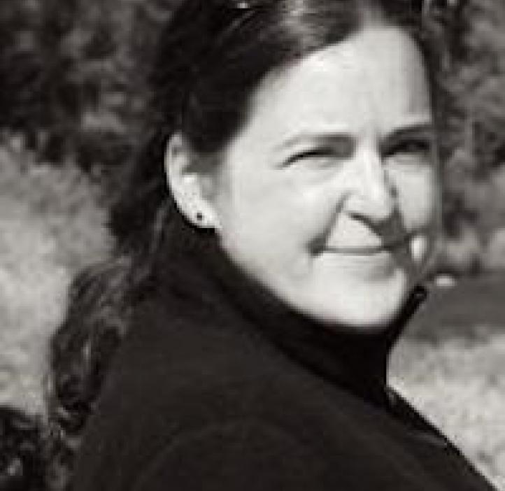 black and white picture of Devon Quick, Integrative Biology professor in field