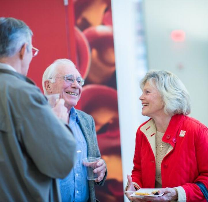 elderly colleagues talking in lobby