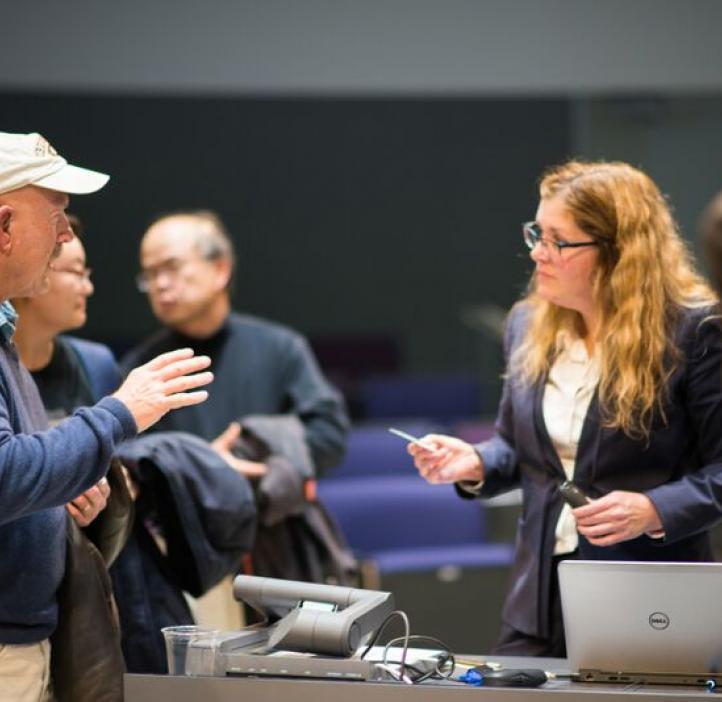 Karen Wooley talking with colleagues